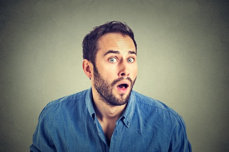 astonished: Portrait of a shocked young man in full disbelief