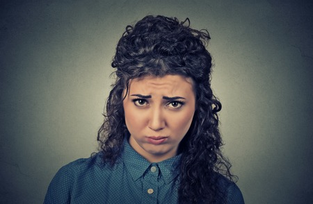aggravated: Closeup portrait of angry young woman, upset about to have nervous breakdown isolated on gray wall background. Negative human emotions facial expression feelings attitude