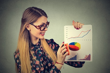 Attractive young woman entrepreneur wiping out excellent good financial wall street market results