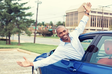 coming out: Happy excited man coming out of a cars window Stock Photo