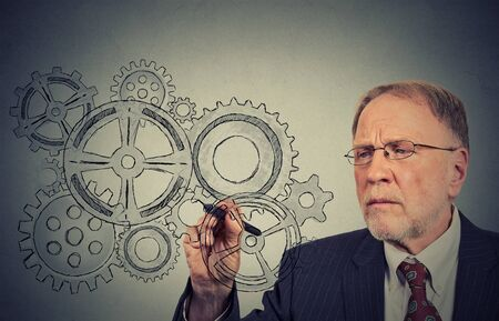 employee satisfaction: Gears and ideas. Senior engineer or elderly businessman leader. Stock Photo