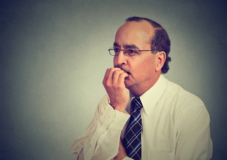 preoccupied: Side profile portrait of a preoccupied anxious concerned middle aged business man in glasses