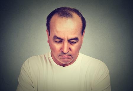 man looking down: Sad man looking down