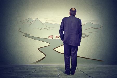 hoping: business man in front of two roads thinking deciding hoping for best taking chance