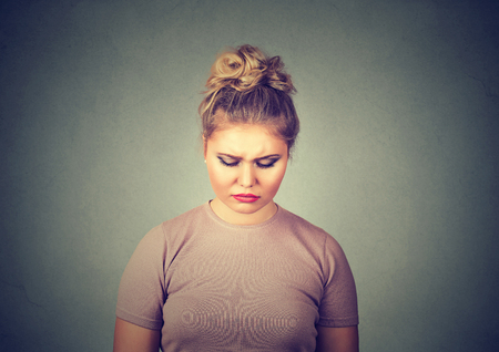 depressed: problems. Sad woman looking down