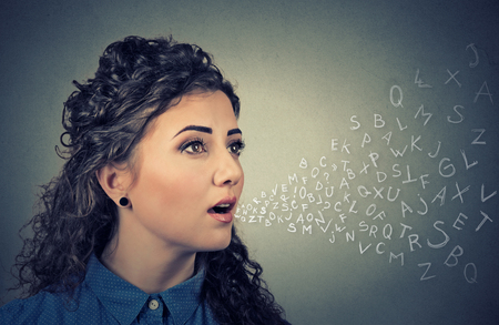 mouth: Woman talking with alphabet letters coming out of her mouth. Communication, information, intelligence concept Stock Photo