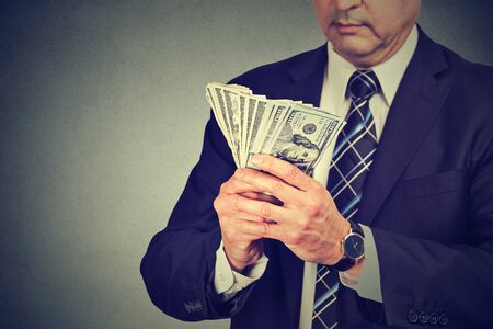 Middle aged businessman counting money