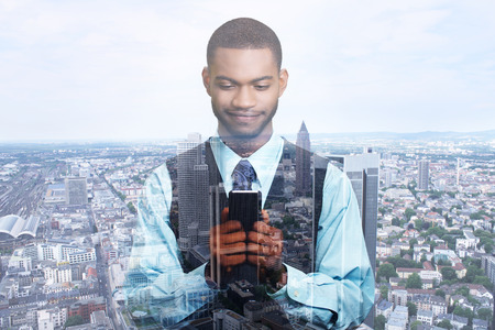 analyzing: Double exposure of happy successful businessman using texting on smart phone business network connection and city center.