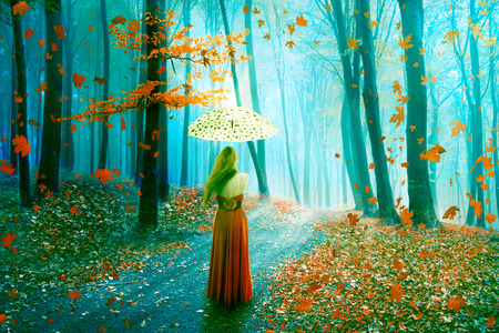 woman alone: Fantasy image of a beautiful lonely young woman with umbrella walking in a forest in fairy and dreamy realm. Nature background