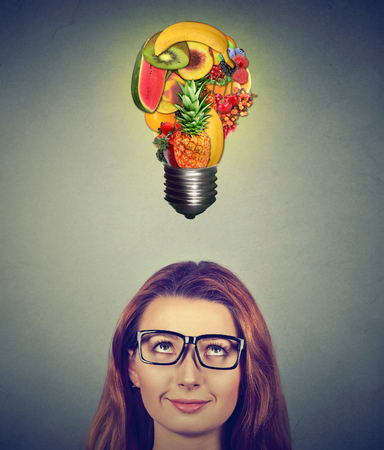 eating healthy idea and diet tips concept woman looking up at