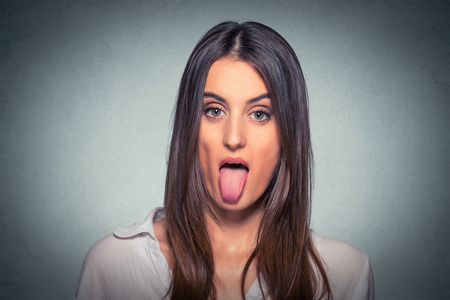 Businesswoman sticking out her tongue Stock Photo - 61267127