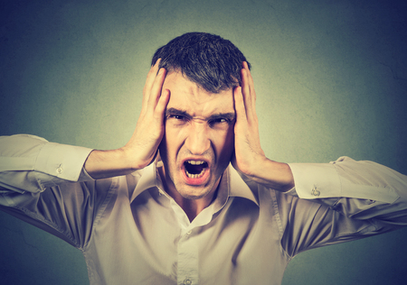 hands on head: Screaming stressed man Stock Photo