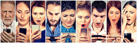 business media: Surprised shocked group of people men women texting on smart phone Stock Photo