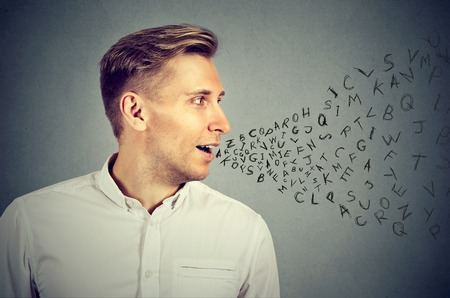 Man talking with alphabet letters coming out of his mouth. Communication, information, intelligence concept Stock Photo