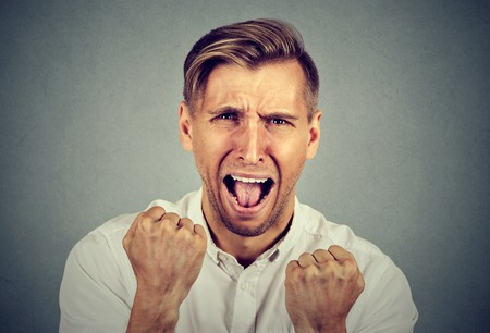 pissed off: Angry young man screaming Stock Photo