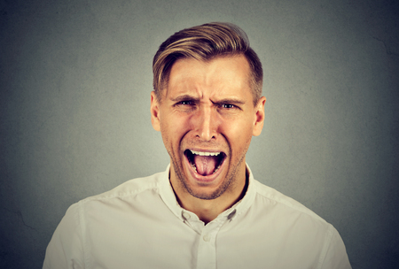 man screaming: Angry young man screaming Stock Photo