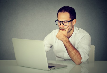 Young man using a laptop computer