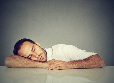 burdensome: Man sleeping on a desk Stock Photo