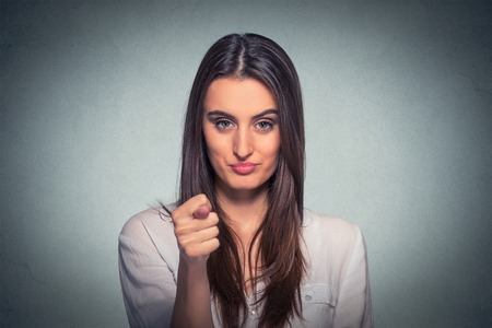 bitchy: Woman giving thumb, finger figa gesture you get zero nothing isolated on gray background. Human emotions, facial expressions, feeling, body language reaction Stock Photo