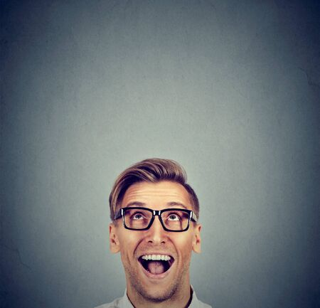 Surprised man looking up Stock Photo