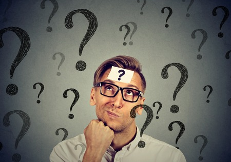 ignorant: Thoughtful confused handsome man has too many questions and no answer Stock Photo