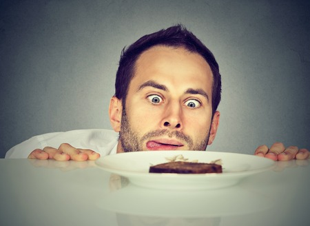 plates of food: Hungry man craving sweet food