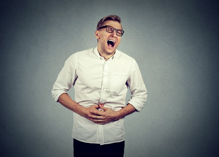indigestion: Young man with stomach pain indigestion