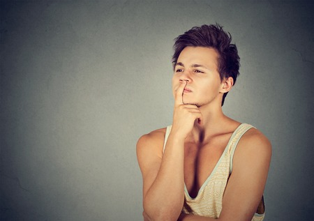 preoccupied: Preoccupied thinking young man looking up Stock Photo