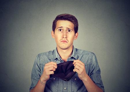 Man with no money. Businessman holding empty wallet Standard-Bild