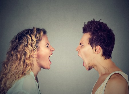 pissed off: Angry young couple screaming face to face.