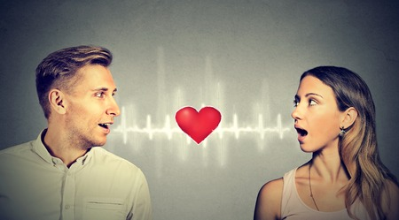 inbetween: Love connection. Man woman talking to each other with red heart in-between