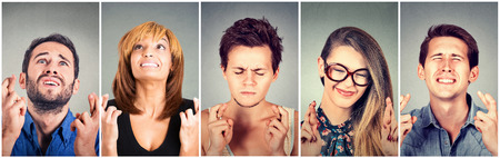 crossing fingers: Group of multiethnic young people hopeful crossing their fingers hoping, asking for best. Human face expressions, emotions, feelings attitude reaction Stock Photo