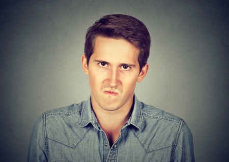 annoyance: Annoyance. Angry displeased young man Stock Photo