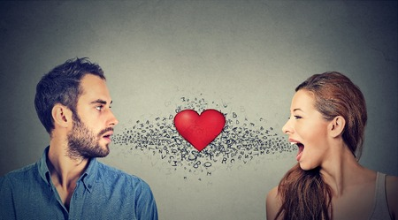 inbetween: Love connection. Man woman talking to each other with red heart in-between and alphabet letters coming out of open mouth. Common language