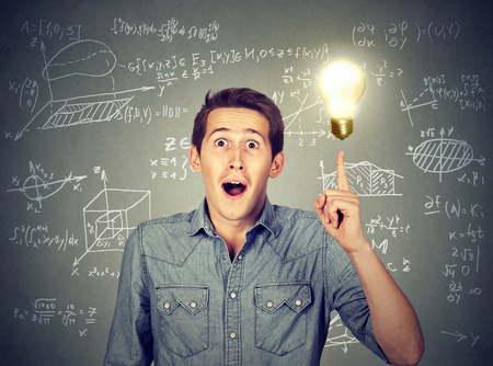 aha: smart student with idea light bulb and various high school maths and science formulas on background