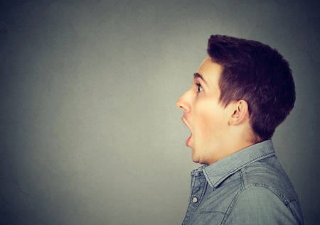 face side: Closeup shocked dazed young man Stock Photo