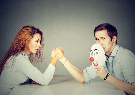 Business people woman and man arm wrestling