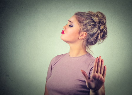 Snobby young annoyed angry woman with bad attitude giving talk to hand gesture with palm outward isolated grey wall background. Negative human emotion face expression feeling body language Stock Photo - 67314705