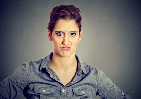 pissed off: Displeased pissed off angry pessimistic woman with bad attitude looking at you Negative human emotion facial expression feeling Stock Photo