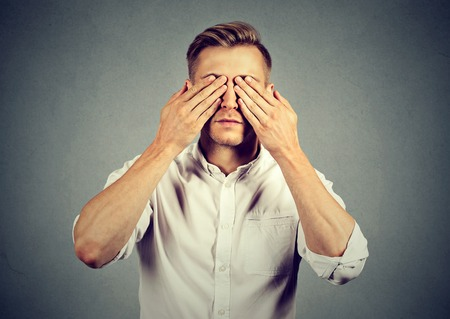 Man covering eyes