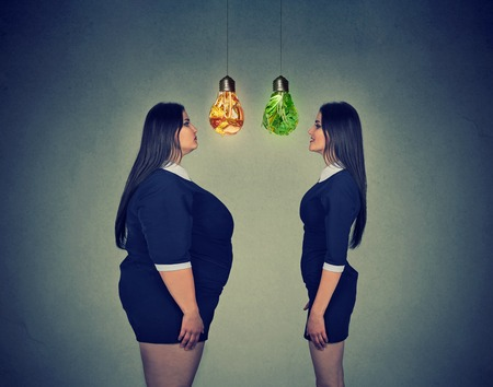 young fat woman looking at happy slim fit girl. Diet choice right nutrition healthy lifestyle concept