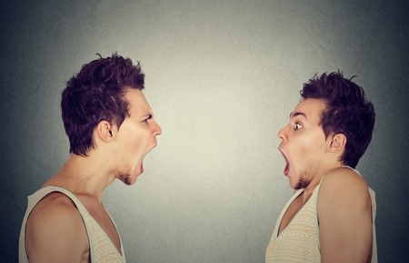 pissed off: Split personality. Angry man screaming at scared himself