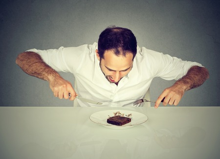 fork and knife: Hungry man craving sweet food pound cake  Stock Photo