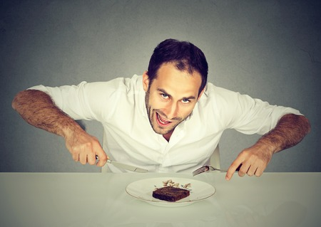 man eating: Hungry man craving sweet food pound cake  Stock Photo