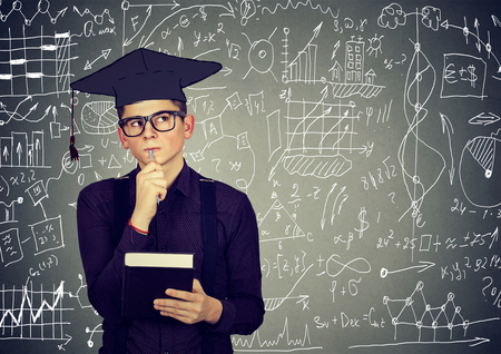 work book: Man in graduation cap with book thinking about education, work life balance planning future standing by info graphics blackboard