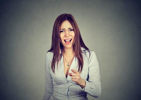 incriminate: angry woman pointing at camera
