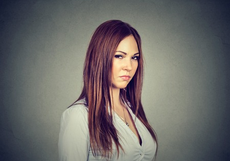 bitchy: Displeased angry pessimistic woman with bad attitude looking at you. Negative human emotion