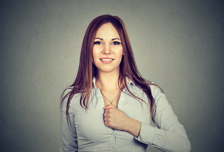important: Super hero girl. Confident young woman isolated on gray wall background