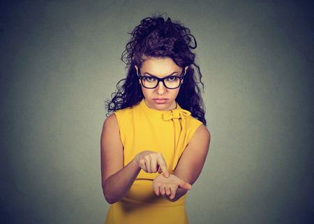 pay money: Young angry woman in yellow dress asking for more money, pay back debt Stock Photo