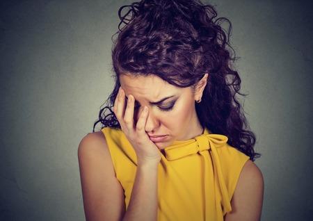 Closeup depressed sad woman leaning head on hand